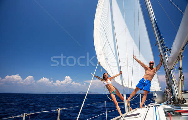 Happy couple on sailboat Stock photo © Anna_Om