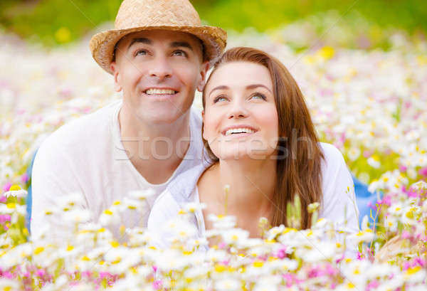 Young family on camomile glade Stock photo © Anna_Om