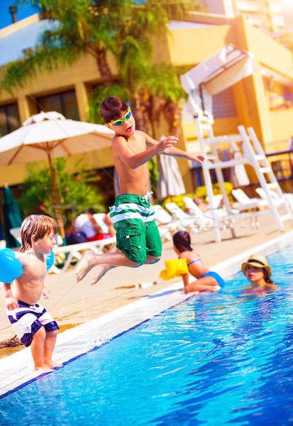 Glückliche Familie Pool Sohn springen Wasser Stock foto © Anna_Om
