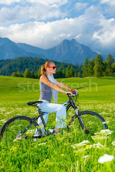 Active woman on bicycle in mountains Stock photo © Anna_Om