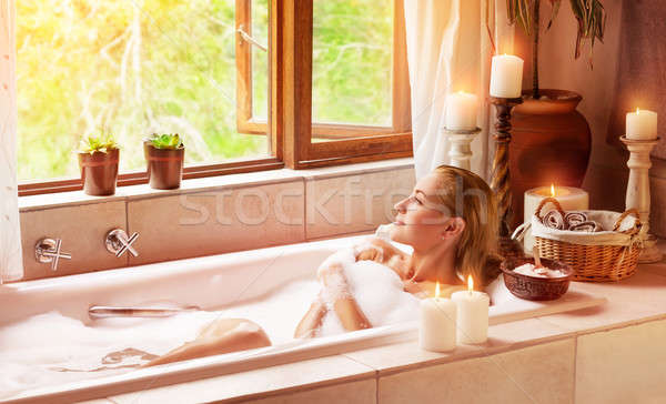 Woman bathing with pleasure Stock photo © Anna_Om