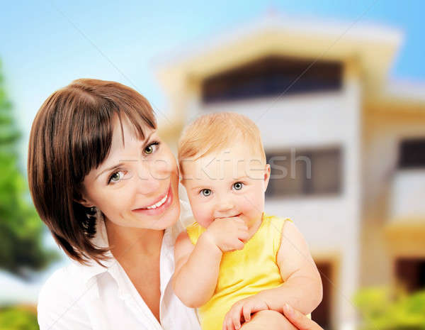 Stock photo: Mother and baby portrait