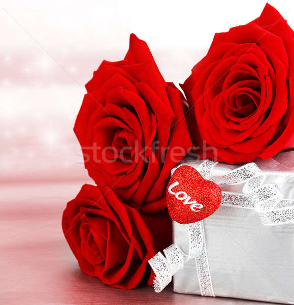 Stock photo: Beautiful roses with gift box & heart