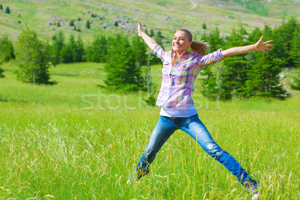 Happy girl jumping on the field  Stock photo © Anna_Om