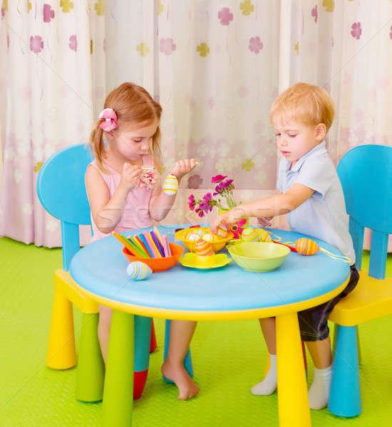 Cute children paint Easter eggs Stock photo © Anna_Om