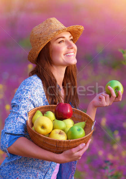 Stock photo: Happy woman with basket of apples