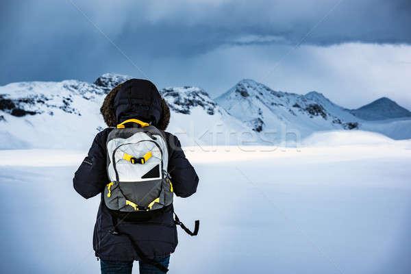 Traveler enjoying winter landscape Stock photo © Anna_Om