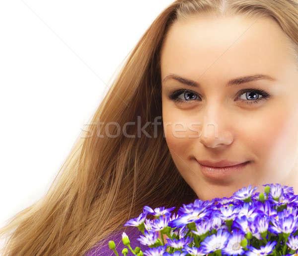 Stock photo: Beautiful female holding flowers