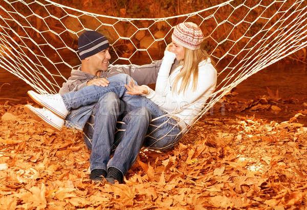 Pareja hablar hamaca feliz sesión Foto stock © Anna_Om
