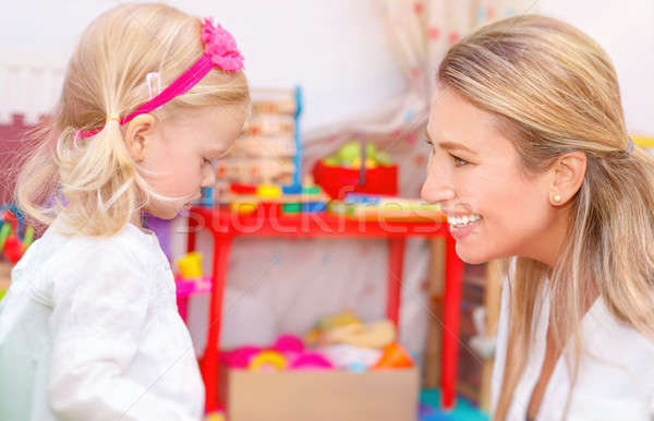 Little girl with mother having fun Stock photo © Anna_Om