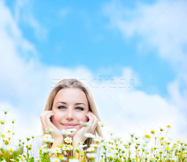 Stock photo: Happy young female over sky