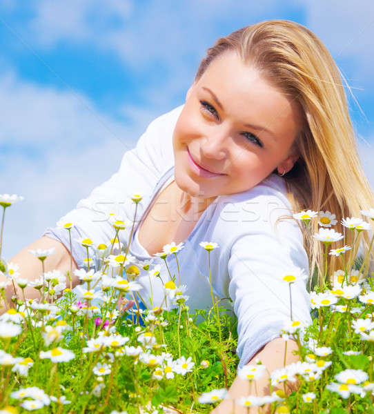 Attractive girl on daisy glade Stock photo © Anna_Om