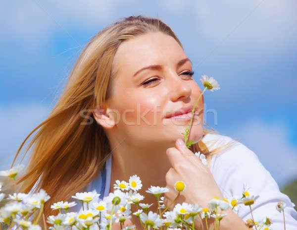 Cute female enjoying daisy smell Stock photo © Anna_Om