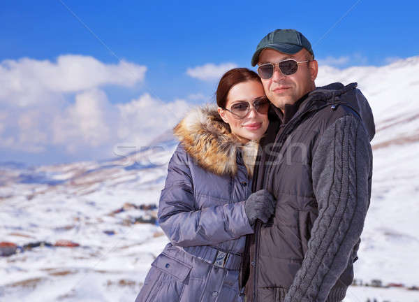 Happy family in winter mountains Stock photo © Anna_Om