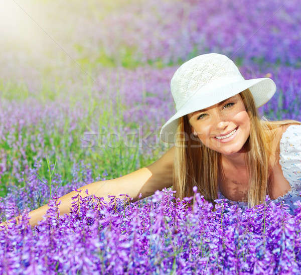 Beautiful happy female lying down on lavender field Stock photo © Anna_Om