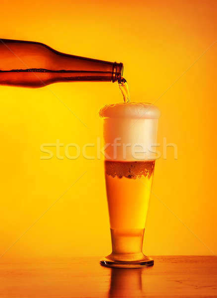 Waiter pouring beer in glass Stock photo © Anna_Om