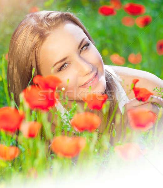 Cute female on poppy field Stock photo © Anna_Om