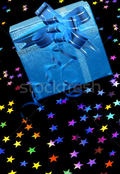 Gift box with stars on black Stock photo © Anna_Om