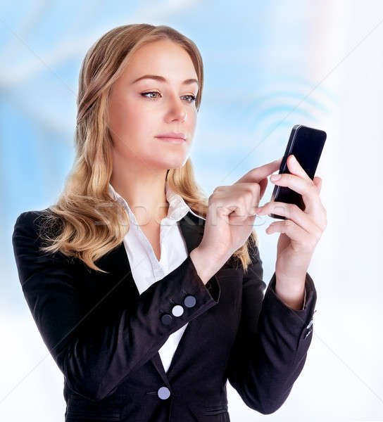 Businesswoman reading text message Stock photo © Anna_Om