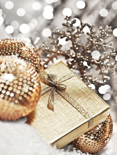 Stock photo: Silver Christmas gift with baubles decorations