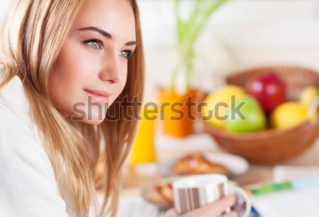Beautiful calm young woman having morning coffee Stock photo © Anna_Om
