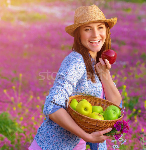 Cheerful woman biting apple Stock photo © Anna_Om