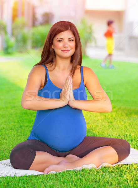 Expectant female doing exercise outdoors Stock photo © Anna_Om