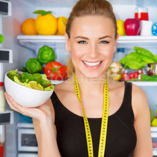 Dietitian with fresh salad Stock photo © Anna_Om