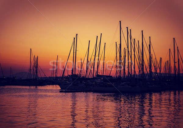 Sailboat harbor on sunset Stock photo © Anna_Om