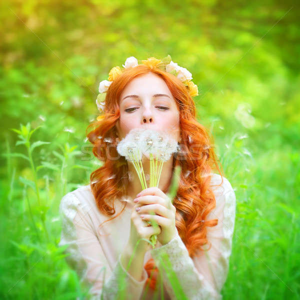 Beautiful female blowing on a dandelion flowers Stock photo © Anna_Om