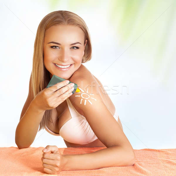 Beautiful girl wearing sunscreen  Stock photo © Anna_Om