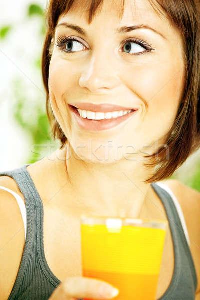 Healthy girl drinking orange juice Stock photo © Anna_Om