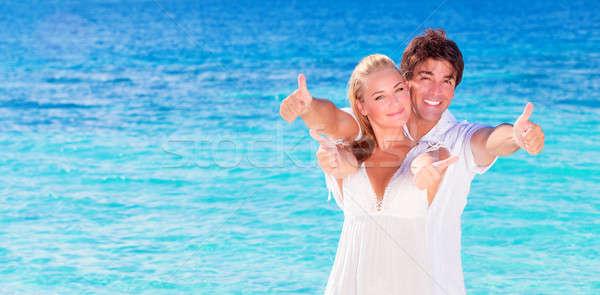 Cheerful couple enjoying beach vacation Stock photo © Anna_Om
