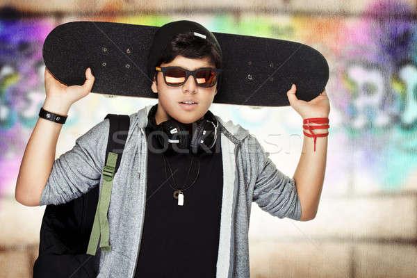 Stylish teen boy with skateboard Stock photo © Anna_Om