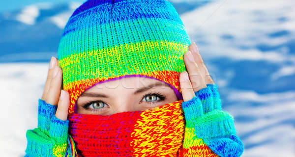 Close up on covered face with blue eyes Stock photo © Anna_Om
