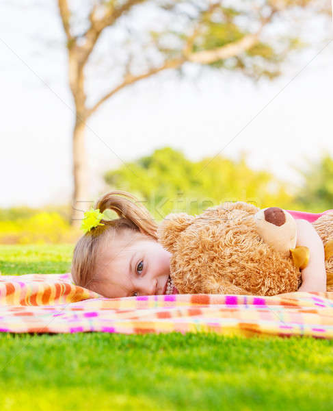 Baby girl lying with soft toy Stock photo © Anna_Om