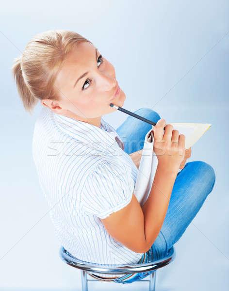 Student girl thinking on exam Stock photo © Anna_Om