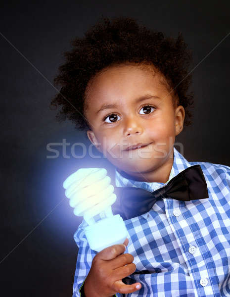 Little genius with illuminated lamp Stock photo © Anna_Om