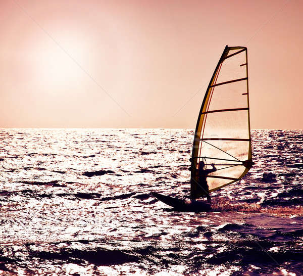 Windsurfer silhouette over sea sunset Stock photo © Anna_Om