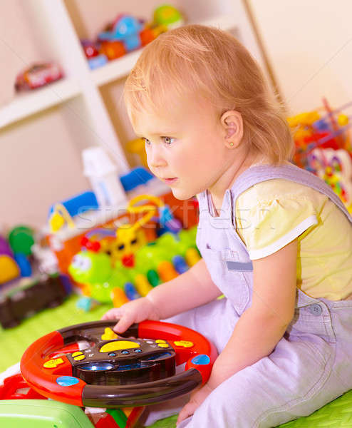 Baby girl in playing room Stock photo © Anna_Om