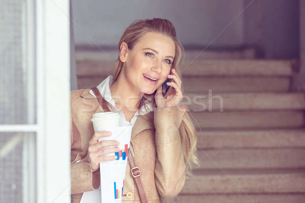 Happy woman talking on the phone Stock photo © Anna_Om