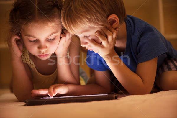Two little kids watching cartoons Stock photo © Anna_Om