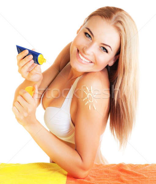 Stock photo: Pretty female apply suntan cream