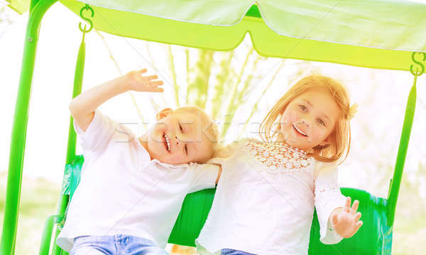 Happy kids on the swing Stock photo © Anna_Om