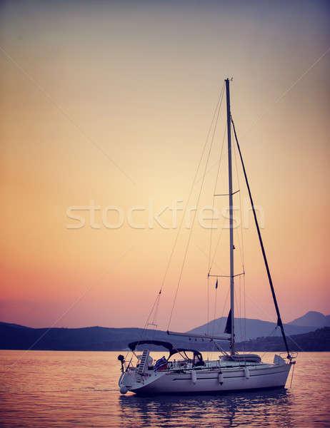 Stock photo: Sailboat in sunset light