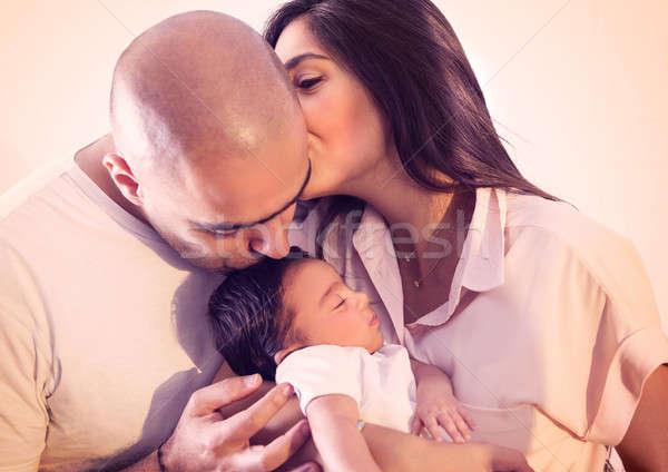 Boldog család portré gyönyörű fiatal szülők tart Stock fotó © Anna_Om