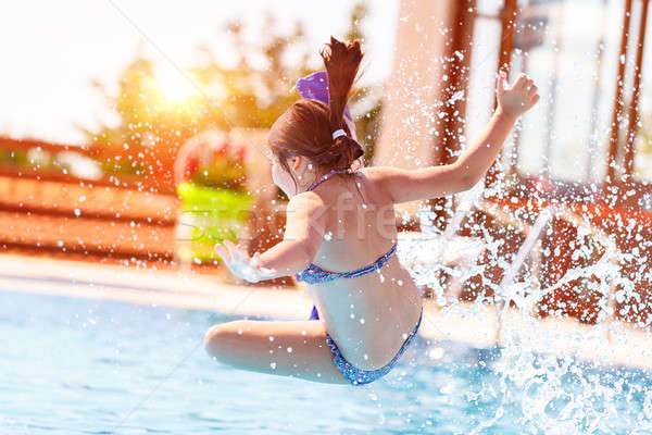 Stock photo: Active little girl in the pool