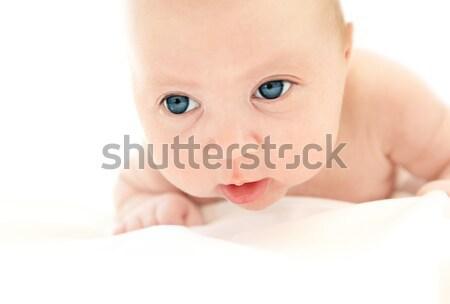 Kicsi baba arc kaukázusi ágy izolált Stock fotó © Anna_Om