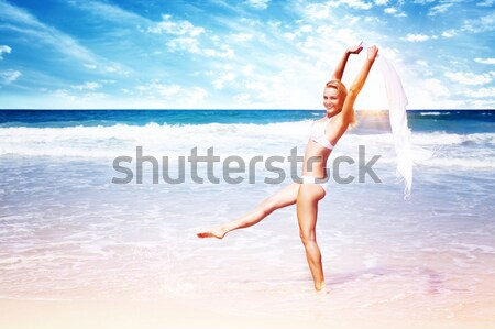 Jumping happy girl on the beach Stock photo © Anna_Om