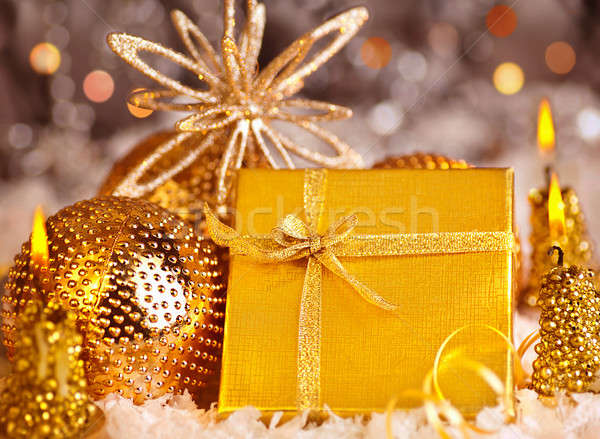 Golden Christmas gift with baubles decorations and candles Stock photo © Anna_Om